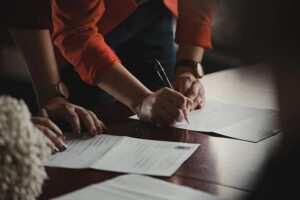 image of someone signing estate planning documents
