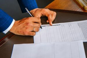 image of person signing documents